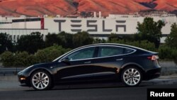 The first production model of Tesla Model 3 from the assembly line in Fremont, California. The handout photo from Tesla Motors obtained by Reuters, July 10, 2017.