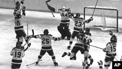 Members of the 1980 U.S. Olympic hockey team celebrate after their upset victory over the heavily favored Soviet team by 4-3 score in the Winter Olympics in Lake Placid, N.Y., on Feb. 22, 1980.