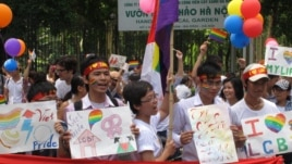 Participants wave rainbow flags during Vietnam's first Gay Pride parade, Hanoi, August 5, 2012. (Marianne Brown/VOA)