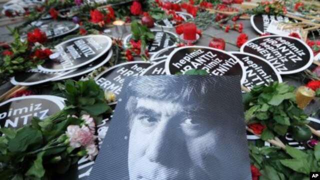Placards and a poster left by friends outside his office as tens of thousands of protesters march to mark the fifth anniversary of Turkish-Armenian journalist Hrant Dink's murder in Istanbul, Turkey,  as outrage continues to grow over a trial that failed