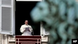 Pope Francis reads the list of 19 new Cardinals during the Angelus prayer in St. Peter's Square, at the Vatican, Jan. 12, 2014