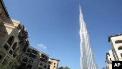 Burj Khalifa, the world's tallest building, seen at center, in Dubai, United Arab Emirates, Sunday, 3 Jan. 2010