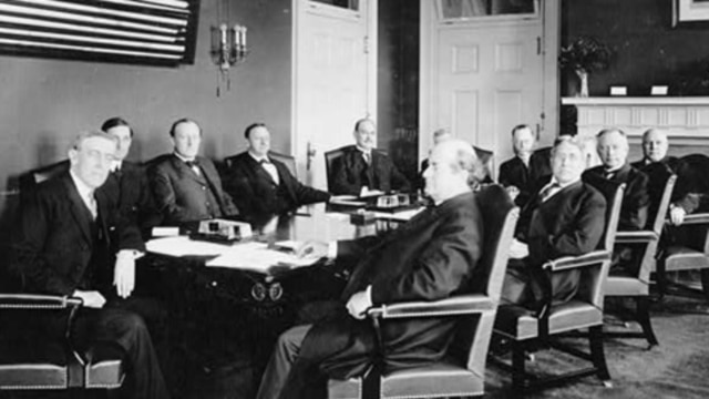 Woodrow Wilson and his cabinet seated around table, 1913