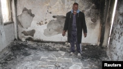 A man inspects his house that was damaged during recent clashes between armed factions in Tripoli's Abu Selem district, Libya, March 1, 2017.