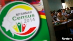 Volunteers attend a census training course at a school in Rangoon, March 23, 2014.