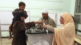 People cast their votes during the final stage of a referendum on Egypt's new constitution in Bani Sweif, about 115 km (71 miles) south of Cairo December 22.