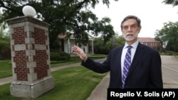 Millsaps College president Robert W. Pearigen speaks about the history of some of the buildings at the small liberal arts college in Jackson, Miss., Friday, April 3, 2020. (AP Photo/Rogelio V. Solis)