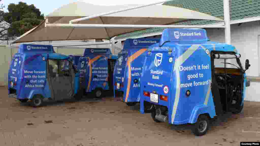 A small fleet of blue Shesha Tuks – advertising a local Standard Bank - await the call of the dispatcher at the company's Johannesburg office. (Photo by Darren Taylor)