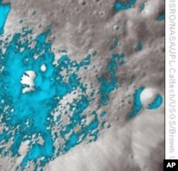 Water-rich minerals (light blue) are shown around a small crater on the far side of the Moon. (AP/Photo)