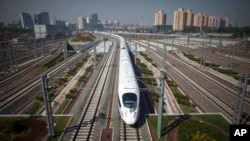 FILE - A CRH high-speed train leaves the Beijing South Station for Shanghai during a test run on the Beijing-Shanghai high-speed railway in Beijing, China.