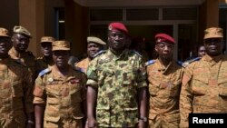 Lieutenant Colonel Yacouba Isaac Zida (C) poses for a picture after a news conference in which he was named president at the military headquarters in Ouagadougou, capital of Burkina Faso, November 1, 2014. Burkina Faso's military backed the presidential g