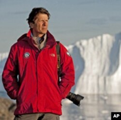 James Balog, pictured here in Greenland, has designed, programmed and installed time-lapse cameras on glaciers to record the impact of a warming climate.