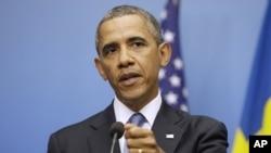 奥巴马总统9月4日在斯德哥尔摩与瑞典首相赖因费尔特举行的联合记者会上