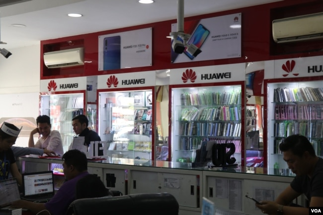 Huawei logos and products are seen advertised at a local phone shop, in Phnom Penh, Cambodia, March 14, 2019. (Sun Narin/VOA Khmer)