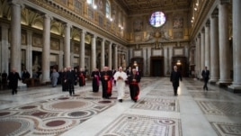 Newly elected Pope Francis (C), Cardinal Jorge Mario Bergoglio of Argentina, walks in the 5th-century Basilica of Santa Maria Maggiore during a private visit in Rome, March 14, 2013.