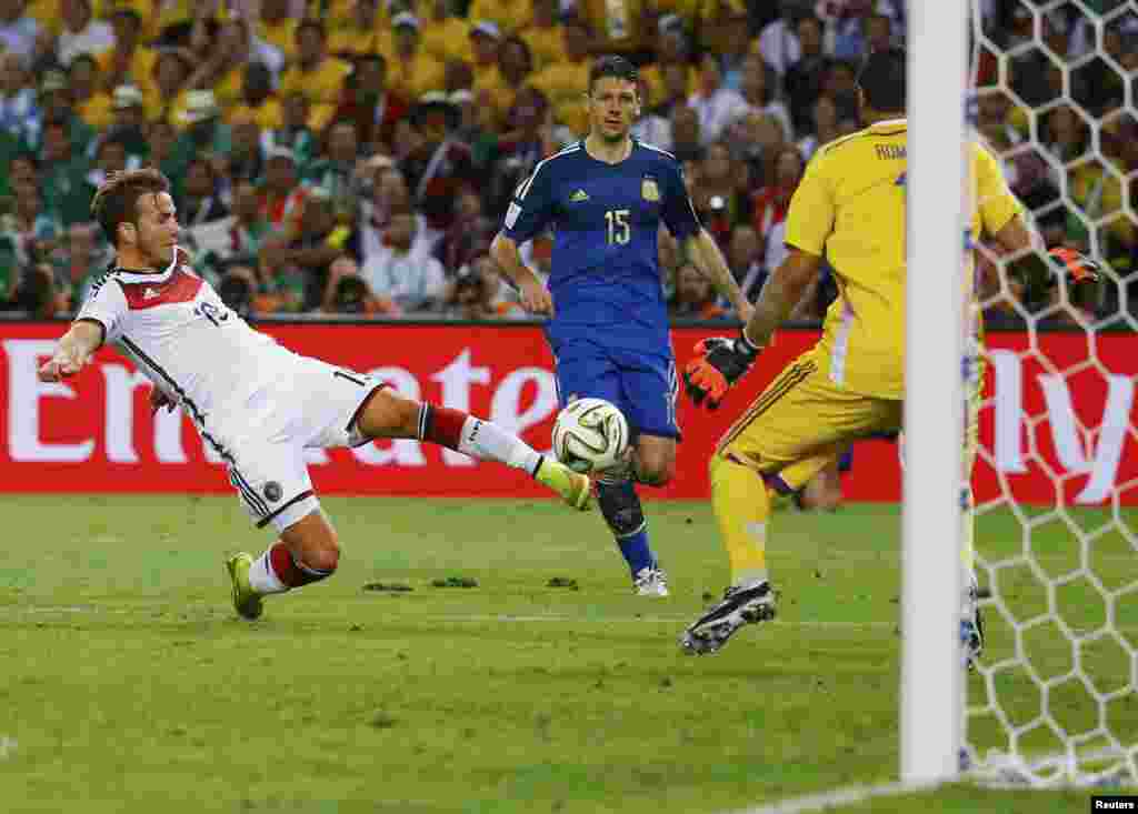Germany's Mario Goetze scores during extra time at the Maracana stadium in Rio de Janeiro, July 13, 2014.