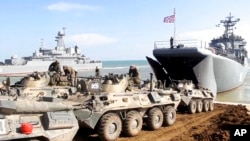 Russian Defense Ministry Press Service shows, Russian military's armored vehicles roll into landing vessels after drills in Crimea. April 23, 2021.