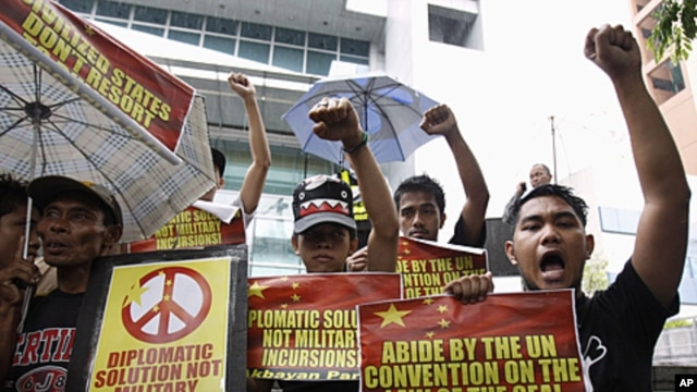 Demonstrators  protest against what Manila claims to be Chinese intrusions into Spratly Islands territories claimed by the Philippines front of the Chinese consulate in Makati's financial district of Manila June 8, 2011.