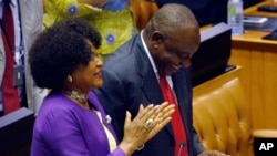 Cyril Ramaphosa is cheered by Parliament Speaker Baleka Mbete, left, after being elected President in Parliament in Cape Town, South Africa, Feb. 15, 2018.