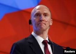 FILE - Carter Page, a one-time adviser of President Donald Trump, addresses the audience during a presentation in Moscow, Dec. 12, 2016.