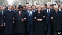 From the left, Israeli Prime Minister Benjamin Netanyahu, Malian President Ibrahim Boubacar Keita, French President Francois Hollande, German Chancellor Angela Merkel, EU president Donald Tusk and Palestinian Authority President Mahmoud Abbas march during a rally in Paris, France, Jan. 11, 2015.