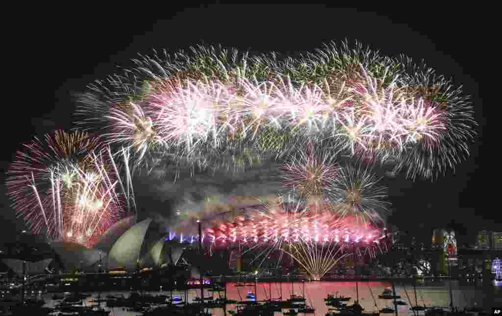 Fireworks explode over the Opera House and Harbour Bridge during New Year's Eve fireworks display in Sydney, Australian, Jan. 1, 2016.