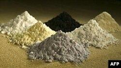 Rare earth oxides from top center clockwise: praseodymium, cerium, lanthanum, neodymium, samarium, and gadoliniun