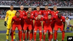 United States men's soccer players pose for a picture before the 2019 Gold Cup final football match between USA and Mexico on July 7, 2019.