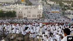 Muslim pilgrims pray on Mount Mercy on the plains of Arafat during the annual haj pilgrimage, outside the holy city of Mecca, Saudi Arabia, November 5, 2011.