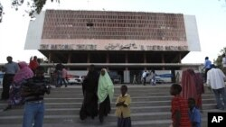 Residents gather outside the reopened National Theater in Somalia's capital Mogadishu, March 19, 2012. In the roofless, bullet-ridden building that houses Mogadishu's National Theater, Somali musicians staged a concert for the first time in 20 years, a si
