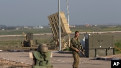An Israeli soldier guards an Iron Dome air defense system deployed in the Israeli controlled Golan Heights near the border with Syria. (File)