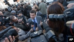 Massimo Carminati's lawyer, Bruno Naso is chased by reporters as he arrives at a court in Rome, Nov. 5, 2015.