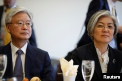 South Korean Foreign Minister Kang Kyung-wha (R), sits with South Korean Ambassador to the United States Ahn Ho-young prior to a meeting with the House Committee on Foreign Affairs in Washington, March 15, 2018.