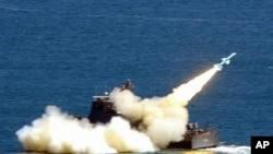 This file photo dated 04 September 2003 shows a Hsiung Feng II ship-to-ship missile being launched.