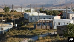 FILE - Amona, an unauthorized Israeli outpost in the West Bank, is seen east of the Palestinian town of Ramallah, Nov. 16, 2016.