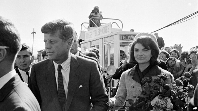 This Nov. 22, 1963 file photo shows President John F. Kennedy and his wife Jacqueline Kennedy upon their arrival at Dallas Airport shortly before President Kennedy was assassinated.