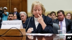 Jill Tahmooressi, mother of Marine Sgt. Andrew Tahmooressi, who has been held for six months in a Mexican jail, reads his letters from confinement, during a House Foreign Affairs subcommittee hearing on Capitol Hill in Washington, Oct. 1, 2014.