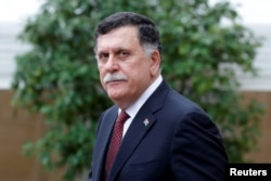 FILE - Libyan Prime Minister Fayez al-Sarraj leaves after an international conference on Libya at the Elysee Palace in Paris, May 29, 2018.