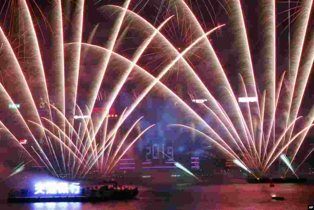 Fireworks explode over the Victoria Harbor during New Year's Eve to celebrate the start of year 2019 in Hong Kong, Jan. 1, 2019.