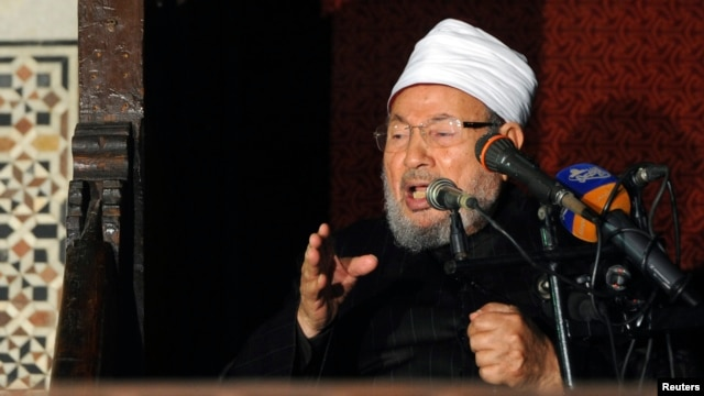 Egyptian Cleric Sheikh Yusuf al-Qaradawi, chairman of the International Union of Muslim Scholars, gives a speech during Friday prayers, before a protest against Syrian President Bashar al-Assad, at Al Azhar mosque in old Cairo, Egypt, Dec. 28, 2012.