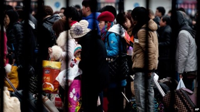 Passengers at the Beijing railway station on February 5, 2013 are among millions returning home for the Chinese Lunar New Year, which starts February 10, 2013.