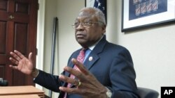 FILE - U.S. Rep. James Clyburn, D-S.C., talks to reporters on Thursday, April 2, 2015, in Columbia, S.C.
