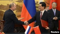 Владимир Путин и Ху Цзиньтао на встрече в Пекине