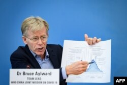 Team leader of the joint mission between World Health Organization and China on COVID-19, Bruce Aylward shows a graphic during a press conference at the WHO headquarters in Geneva on Feb. 25, 2020.