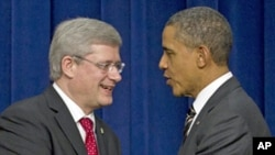 President Barack Obama (r) and Canadian Prime Minister Stephen Harper at the White House complex Dec. 7, 2011.