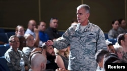 FILE - Lt. Gen. Jay Silveria, superintendent of the U.S. Air Force Academy, discusses his goals and priorities to an audience of Total Force Airmen at the United States Air Force Academy in Colorado, Aug.17, 2017.