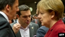 FILE - Italian Prime Minister Matteo Renzi (left), Greek Prime Minister Alexis Tsipras, European Parliament President Martin Schulz and German Chancellor Angela Merkel confer during a European Council summit in Brussels, March 19, 2015.