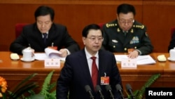 China's parliament chief Zhang Dejiang delivers a work report during the second plenary session of the National People's Congress at the Great Hall of the People in Beijing, March 8, 2015.