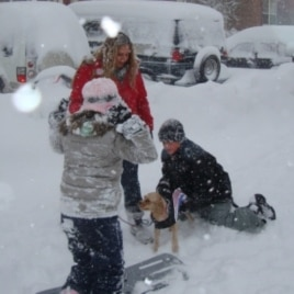 A woman and her children walking their dog and playing in the snow, Fairfax, Virginia, 7 Feb. 2010