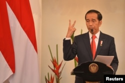 FILE - Indonesian President Joko Widodo delivers a speech at Foreign Ministry office in Jakarta, Indonesia, Feb. 12, 2018.